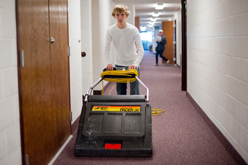 16 year old Erik Mollinet vacuums the hall ways of his church. He donates his time so that they can save money on janitorial services. In Layton on January, 31 2014