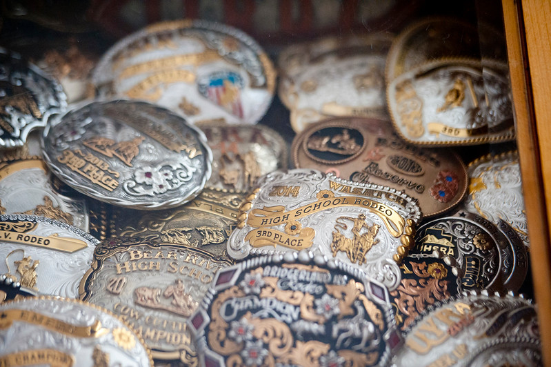 Ladd King has countless belt buckles that him and his siblings have won over the years in Kaysville on July 22, 2015.