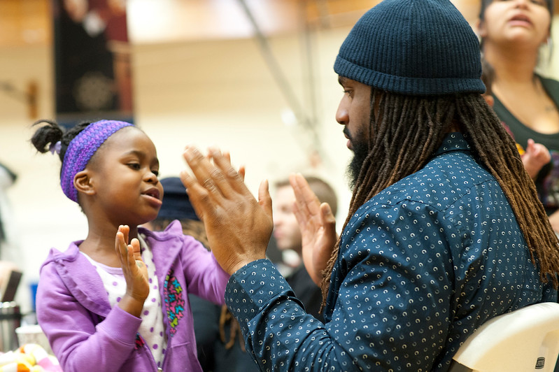 Father and daughter have a candid moment playing together during celebration of Martin Luther King. At the Marshall White Center in Ogden. January 20 2014. (Brian Wolfer Special to the Standard-Examiner)