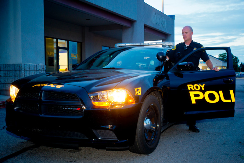 Former marine Matt Gwynn is with Roy Police Department and doing heavier patrols at his city's recruitment center. The officers are patrolling the area more heavily and stopping in the parking lot when there is extra paper work to do in Kaysville on July, 23 2015.