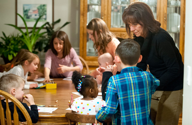 Jan Zogmaister has been named as Utah State Mother of the Year. She serves her grandchildren cookies after doing a lesson on Abraham Lincoln. In West Haven on February 24, 2015.