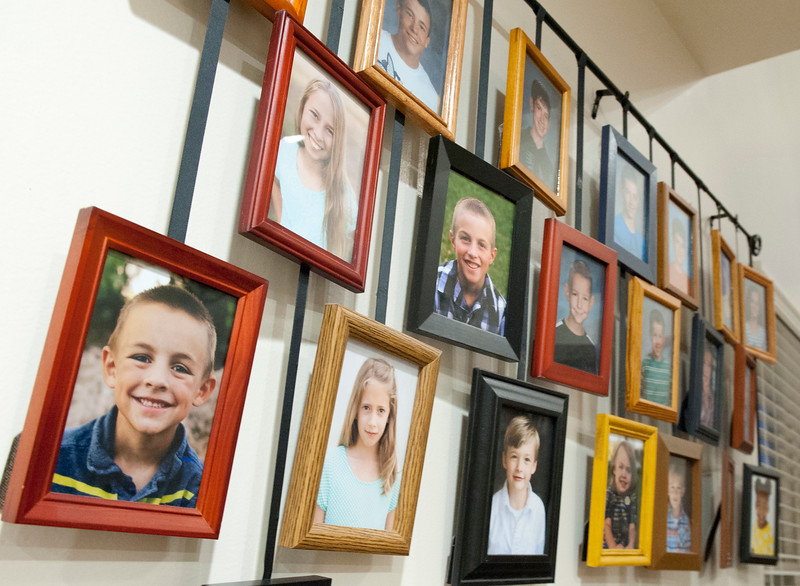 Pictures hang on the wall that display all of Jan Zogmaister 's grandchildren. She was recently with being Weber County Mother of the Year. She is planning a trip to washington D.C where she will be giving speeches. In West Haven on February 24, 2015.