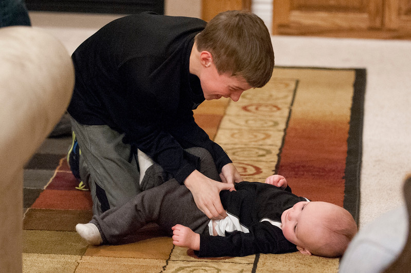 Family members Jack and baby Jaimus share a moment after dinner. Their grandma was awarded with being Weber County Mother of the Year. In West Haven on February 24, 2015.