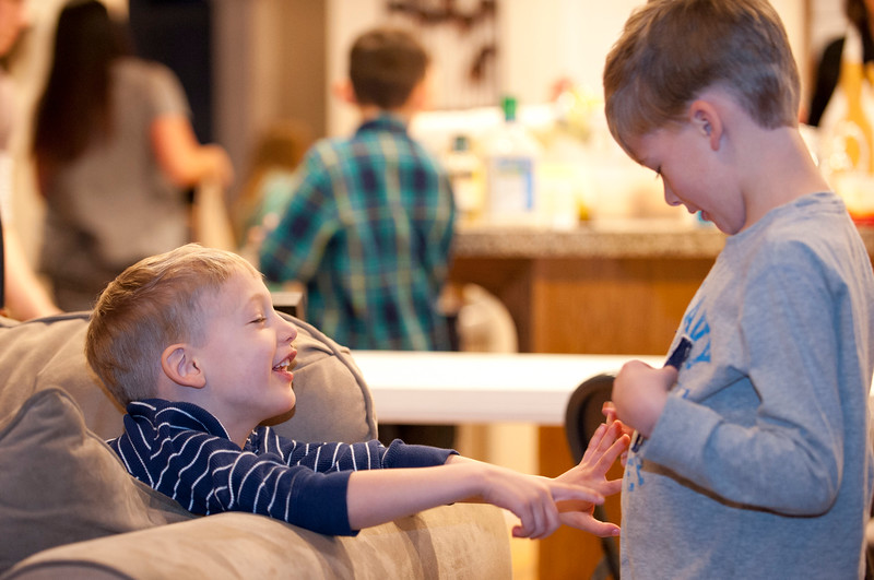 Jan Zogmaister 's grand babies Jack and Max have fun after dinner. They get ready for a family activity where they learn about American History. In West Haven on February 24, 2015.