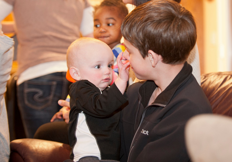 Family members Jack and baby Jaimus share a moment after dinner. Their grandma was awarded with being Weber County Mother of the Year. She is planning a trip to washington D.C where she will be giving speeches. In West Haven on February 24, 2015.