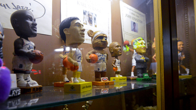 JC Warby displays her collectable Jazz bobble heads in a case at the Old Man Saloon in Ogden. On December 20 2013. (Brian Wolfer Special to the Standard-Examiner)