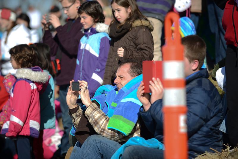 400 people show up to the Poler Plunge according to organizer Kim Lovell. Spectators try and catch a great reaction photo of students jumping into frozen pond.  On January 25 2014. (Brian Wolfer Special to the Standard-Examiner)