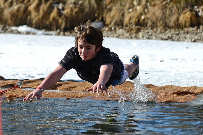 North Davis Prep Academy holds fundraiser and Polar Plunge. The community gathers to watch the brave paretic paints take to the icy water In Ogden. On January 25 2014. (Brian Wolfer Special to the Standard-Examiner)