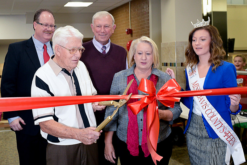 Don Perkins Cuts the ribbon at the Bountiful High School open house. He has been with the school since 1951. Principal Greg Wilkey and former principal Rulan Homer and also Barbra Smith speak on this occasion. On September 11 2013. (Brian Wolfer Special to the Standard-Examiner)