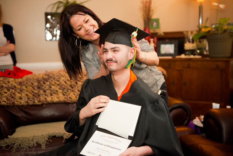 Mariah Evans and her son Riley Person's share a smile at the home graduation. He has osteosarcoma, a cancer in his bone and hip, and has been given only months left to live. In North Salt Lake.  On February 10 2014. (Brian Wolfer Special to the Standard-Examiner)