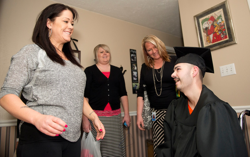 Riley Person has a special graduation celebration at his house. He has osteosarcoma, a cancer in his bone and hip, and has been given only months left to live. In North Salt Lake.  On February 10 2014. (Brian Wolfer Special to the Standard-Examiner)