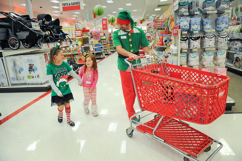 Dr Jake Woodruff walks kids around target and helps them find gifts as part of the Ogden Clinic's Shop with a Doc event. On December 7 2013.(Brian Wolfer Special to the Standard-Examiner)