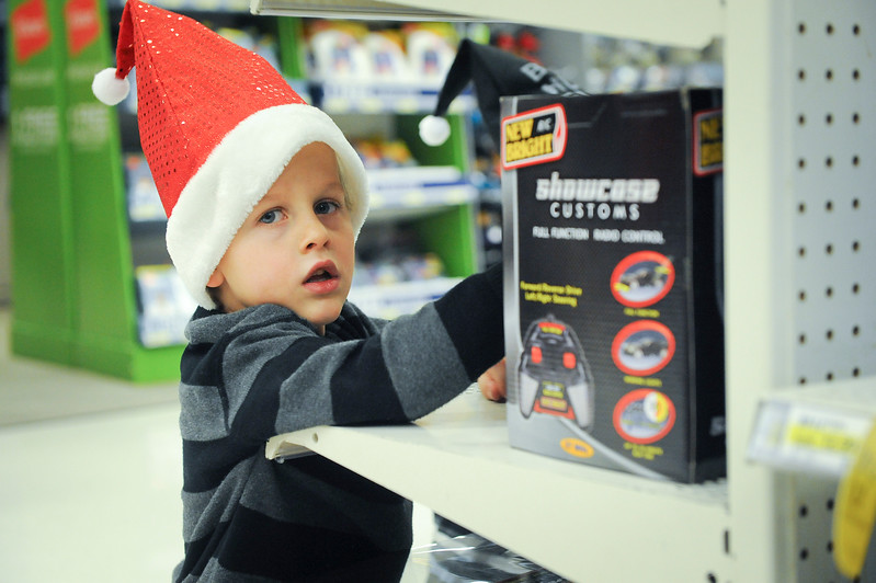 Little helper of the Ogden Clinic has fun while helping needy kids find toys. At Target in Riverdale. On December 7 2013.(Brian Wolfer Special to the Standard-Examiner)