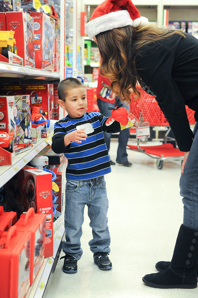 Doctors volunteer their time by helping needy kids get gifts for christmas. At Target in Riverdale. On December 7 2013.(Brian Wolfer Special to the Standard-Examiner)