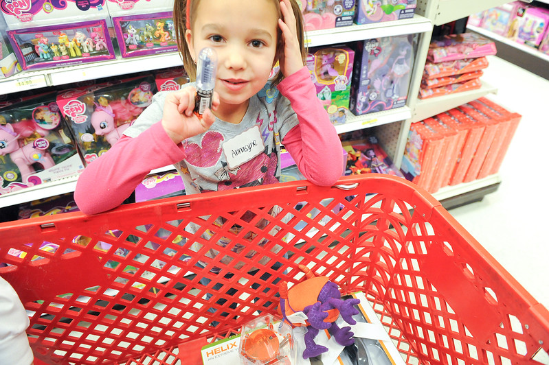 Little Annasyne enjoys her time shopping with doctors as part of the Ogden Clinic's annual Shop with a Doc event. At Target in Riverdale. On December 7 2013.(Brian Wolfer Special to the Standard-Examiner)