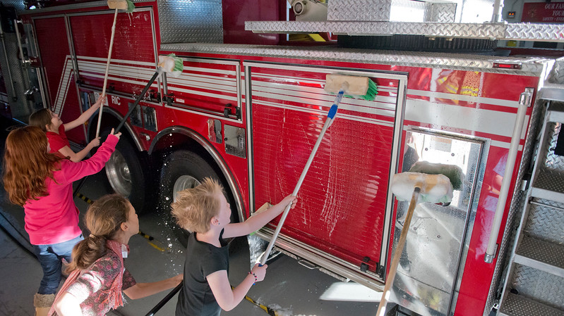 Students there are doing several different service projects to honor Martin Luther King Jr.  They start their by cleaning Roy City's fire trucks. In Roy. On January 23 2014. (Brian Wolfer Special to the Standard-Examiner)