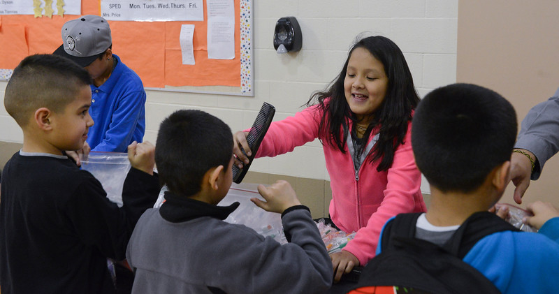 Students from Odyssey Elementary put humanitarian kits together for needy families. In Ogden. On January 23 2014. (Brian Wolfer Special to the Standard-Examiner)