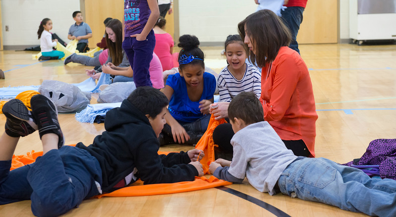 Odyssey Elementary students make blankets for families that are having a hard time getting basic needs. In Ogden. On January 23 2014. (Brian Wolfer Special to the Standard-Examiner)