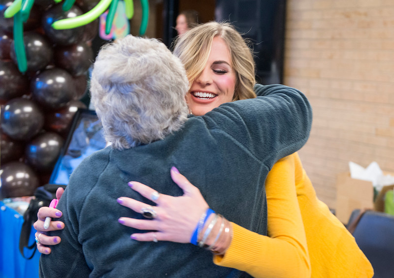 "Sierra Dawn Thomas hugs Phyllis Tuller a close family friend at the Survivor viewing party. Phyllis refers to Sierra Dawn Thomas as her ""secret grandma"". At Roy High School on February 25, 2015"