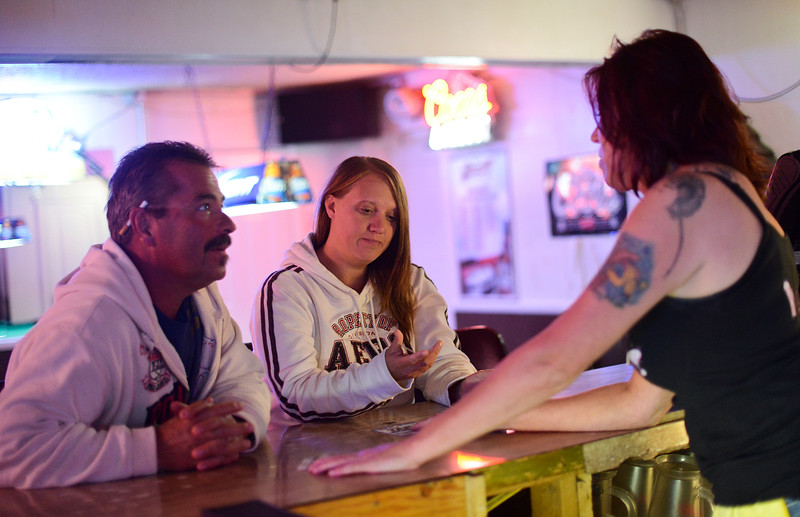Brittany Rice (middle) and Droy smith (left) learn of the struggles that Tammy Jo Summers has been going through. Droy offers his services of roof repair to help out any way he can. In Ogden, On September 25 2013.(Brian Wolfer Special to the Standard-Examiner)