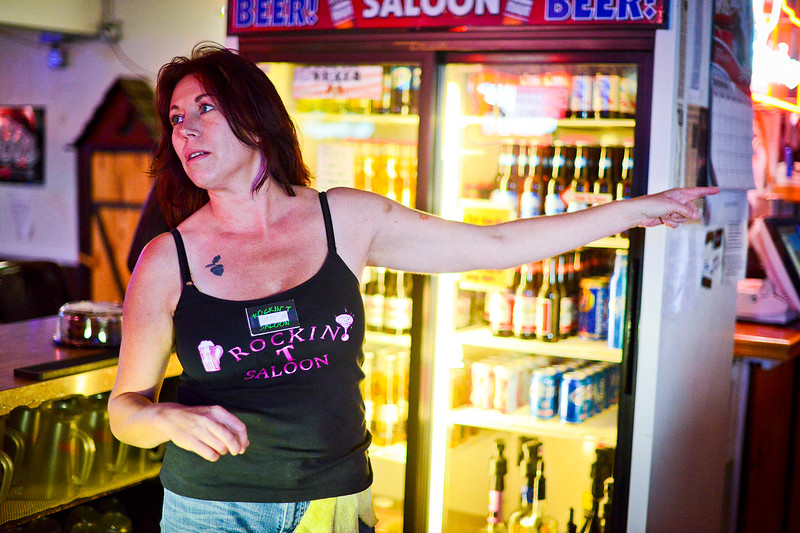 Tammy Jo Summers is trying to stay positive after a bad run of luck.  Bar patrons help out any way they can. In Ogden, On September 25 2013.(Brian Wolfer Special to the Standard-Examiner)