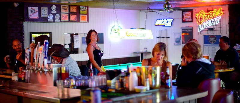 Bartender Tammy Jo Summers walks all around the Rockin T Saloon and takes care of her customers. Tammy recently has has a bad run of luck but her coworkers at the bar and a couple of patrons stepped in to help out. In Ogden, On September 25 2013.(Brian Wolfer Special to the Standard-Examiner)
