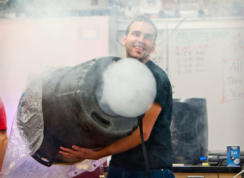 Collin Hoggard does a demonstration with smoke. He blows big smoke rings out of the bottom of a trash can. At Northridge High School in Layton on March, 23 2015.
