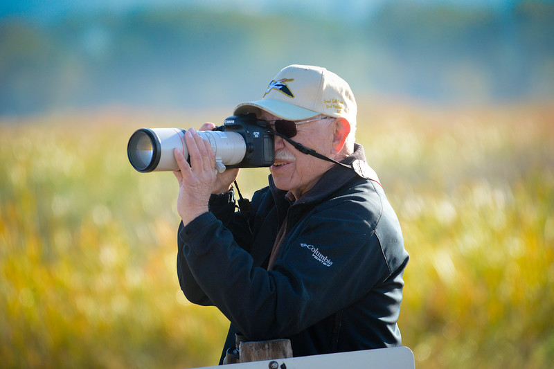Fellow birder Doug Murray takes pictures with his DSLR camera during the educational fundraiser for the Shared Solution. In Farmington on October 5 2013. (Brian Wolfer Special to the Standard-Examiner)