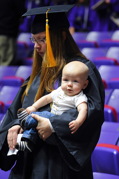 WSU graduate walks her baby down to the stage to receive her degree. At Dee Events Center, on December 13 2013.(Brian Wolfer Special to the Standard-Examiner)