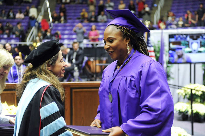 Lina Wembi receives her associates degree at WSU. At Dee Events Center, on December 13 2013.(Brian Wolfer Special to the Standard-Examiner)