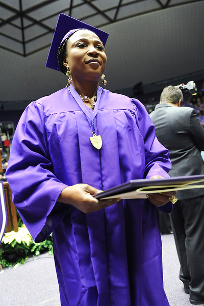 On friday Lina Wembi receives her associates degree at WSU. At Dee Events Center, on December 13 2013.(Brian Wolfer Special to the Standard-Examiner)