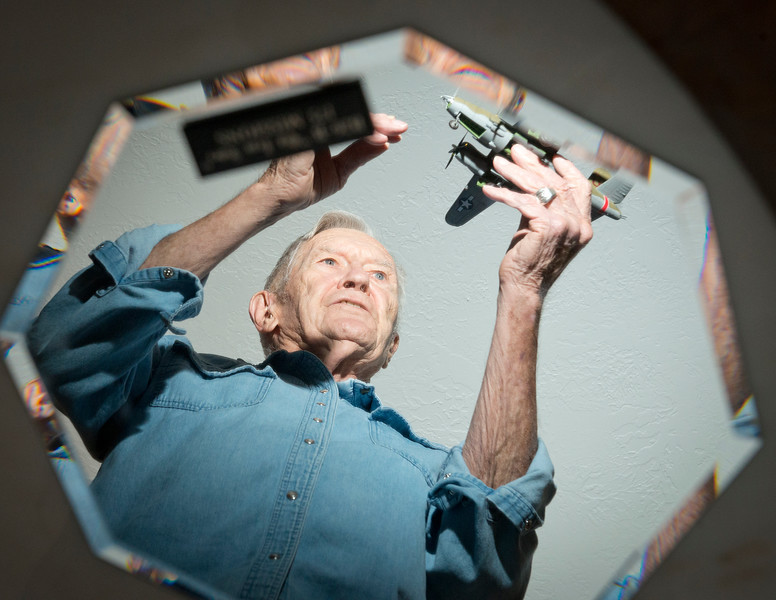 Shot through a mirror, Roy Stapp explains his experiences as a B-26 bomber pilot in WWII. In Bountiful, On January 15 2014. (Brian Wolfer Special to the Standard-Examiner)<br />