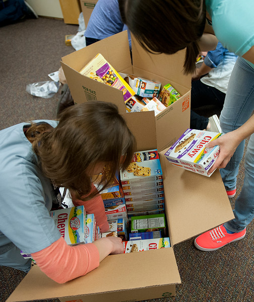 Weber High Students and the HOSA club collect food for kids in our area that go home hungry over the weekends by making snack packs that they can take with them at the end of each week. On February 5 2014. (Brian Wolfer Special to the Standard-Examiner)