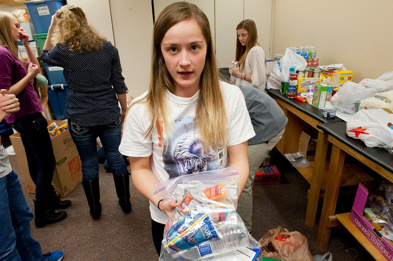 The HOSA club at Weber High is doing a large service project associated with the Souper Bowl of caring. Ellie Zurbuchen shows the snack packs consists of. On February 5 2014. (Brian Wolfer Special to the Standard-Examiner)