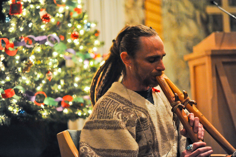 Russ Taylor plays the flute to at the World Aids Day Candlelight Ceremony. His soothing sounds calm people at the ceremony. At the Congregational Untied Church of Christ in Ogden. On December 2 2013.(Brian Wolfer Special to the Standard-Examiner)