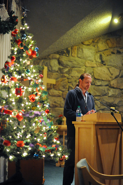 Denis Leavitt shares his experience with having AIDS at the World Aids Day Candlelight Ceremony. The gathering was to spread awareness.  At the Congregational Untied Church of Christ in Ogden. On December 2 2013.(Brian Wolfer Special to the Standard-Examiner)