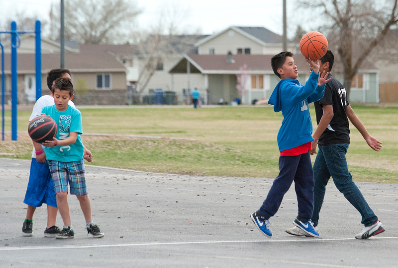 Students play outside after getting a fresh meal provided by YMCA Community Family Center in Ogden on Wednesday March, 25 2015.