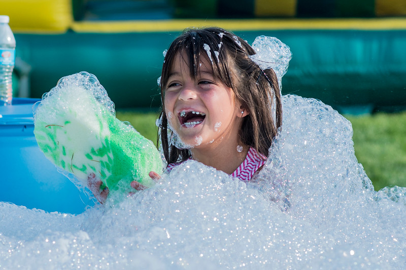 During Roy Days 2017 Bella Rader laughs as she tries to find a sponge in the bubble pit on the obstacle course. The even if filled with food, music and fireworks on August 3, 2017.