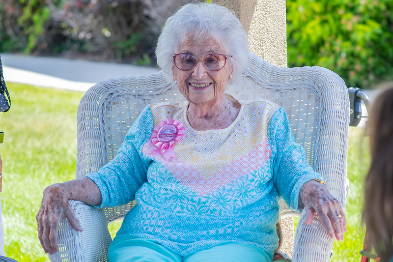 Ruth Pledger's family gathers to calibrate her 104th birthday at the Quail Meadow Assisted Living center in North Ogden, on June 12, 2021.