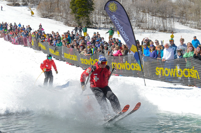 Ski patrol Hans Hjelde (right) leads and holds the rescue toboggan that Maddey Frey rides in. Rich Webb (Left) follows them in during the Snowbasin Pond Skim in Huntsville on Saturday April 15, 2017.