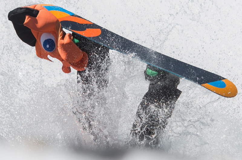 Collin Holmen cartwheels into the water during the Snowbasin Pond Skim. He traveled from Tucson Arizona to participate in the event on Saturday April 15, 2017 in Huntsville.