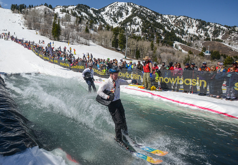 Morgan High School students Colin Smith (right) and Weston Blocker (left) compete in the 2017 Snowbasin Pond Skim as LDS missionaries. Participants dress up in different customs to create a fun atmosphere in Huntsville on Saturday April 15, 2017.