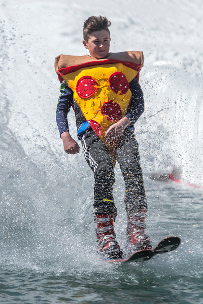 Participants dress up in various customs and participate in the Snowbasin Pond Skim in Huntsville on Saturday April 15, 2017.