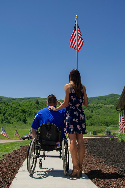 Travis Vendela and his wife Tiffany salute the flag at their new house gifted to them.Travis, who lost both legs after an IED attack in Iraq in 2007, was surprised with a home. On July 3, 2020 in Huntsville.