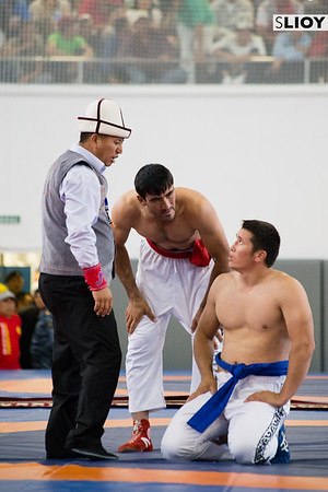 Two wrestlers await the judges decision at World Nomad Games 2016 in Kyrgyzstan.