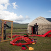 Two Kyrgyz men practice constructing a traditional yurt tent in preperation for speed competitions at World Nomad Games 2016 in Kyrgyzstan.