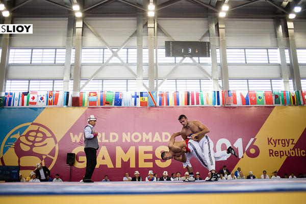 Wrestlers compete before the judges at World Nomad Games 2016 in Kyrgyzstan.