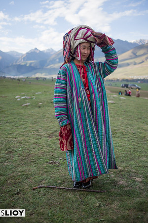 A young girl poses in the traditional costume of Alai region during the World Nomad Games 2016 in Kyrgyzstan.