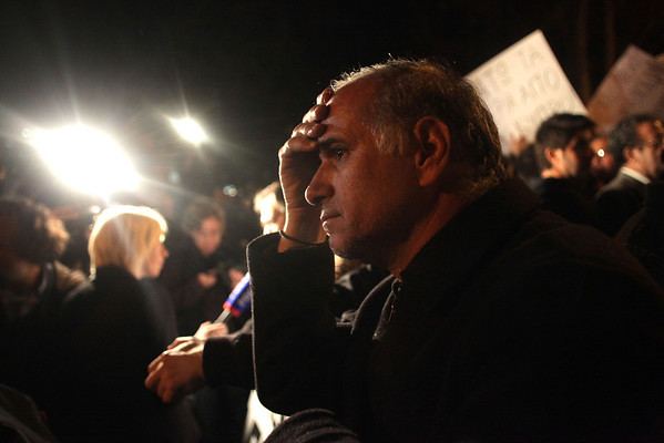 A Cypriot looks on dejected during a protest outside the Parliament on March 21, 2013 in Nicosia.