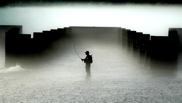 Foggy Fisherman at South Holston Weir Dam.